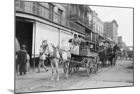 Woman Driving Horse-Drawn Wagon on Street--Mounted Photographic Print