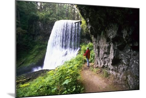 Hiker Looking at Waterfall-Craig Tuttle-Mounted Photographic Print