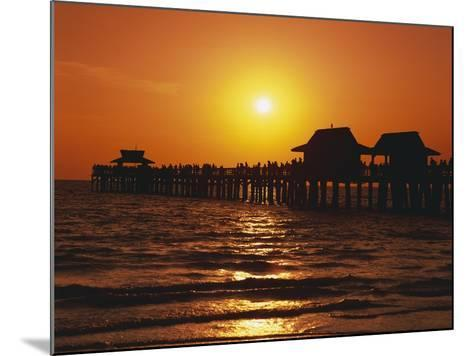 Sun Setting Above Naples Pier-James Randklev-Mounted Photographic Print