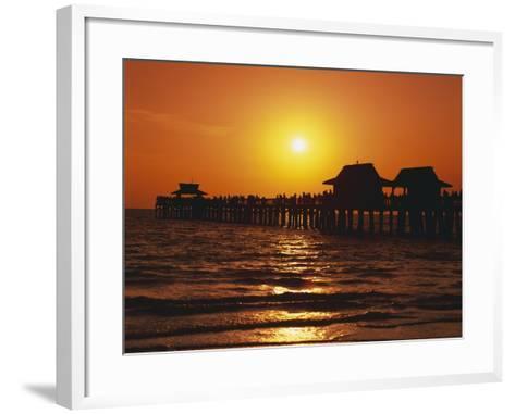 Sun Setting Above Naples Pier-James Randklev-Framed Art Print