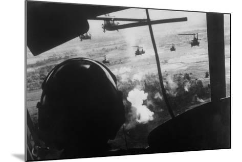 Bell Uh-1 Huey Squadron Firing on Vietcong-Dirck Halstead-Mounted Photographic Print
