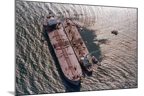 Tanker Pumping Oil from Exxon Valdez--Mounted Photographic Print