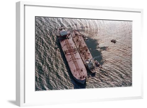 Tanker Pumping Oil from Exxon Valdez--Framed Art Print
