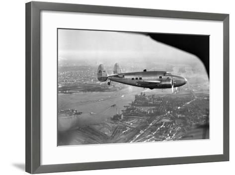 Howard Hughes Lockheed 14 Super Electra over New York City--Framed Art Print