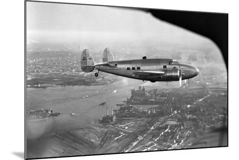 Howard Hughes Lockheed 14 Super Electra over New York City--Mounted Photographic Print