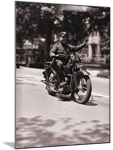 Police Officer on Motorcycle-Philip Gendreau-Mounted Photographic Print