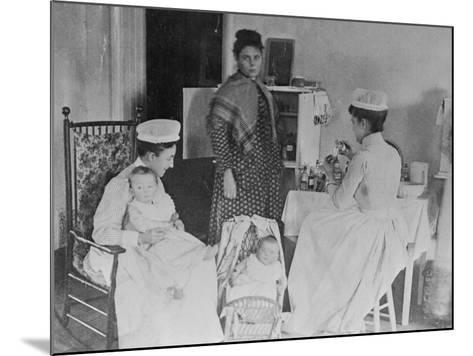 Nurses Caring for Children in Hospital--Mounted Photographic Print