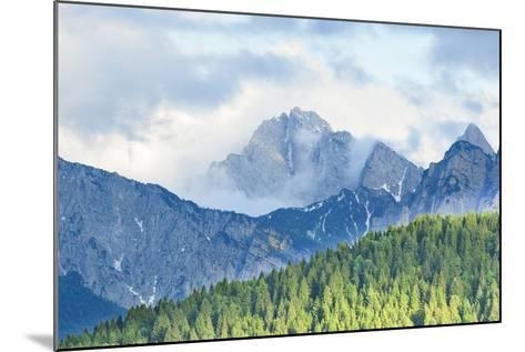 The Mount Sernio Emerges from the Clouds and Stands with Majesty Abiove the Green Woods, Alpi Carni-Gabriele Bano-Mounted Photographic Print