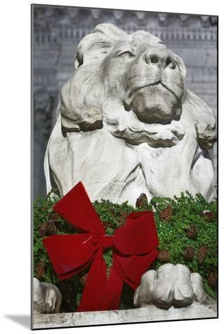 New York Public Library Lion Decorated with a Christmas Wreath during the Holidays.-Jon Hicks-Mounted Photographic Print