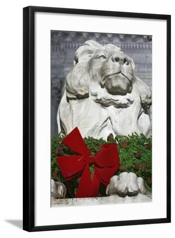 New York Public Library Lion Decorated with a Christmas Wreath during the Holidays.-Jon Hicks-Framed Art Print
