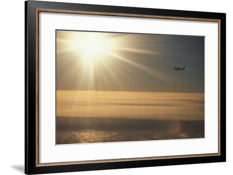 Airplane Flying over Ice-DLILLC-Framed Art Print