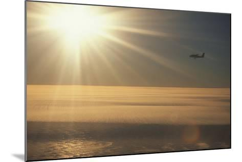 Airplane Flying over Ice-DLILLC-Mounted Photographic Print