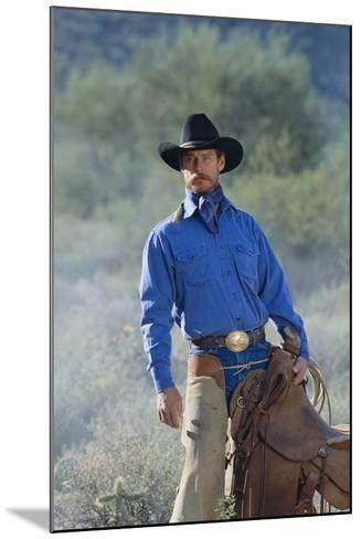 Cowboy with His Saddle-DLILLC-Mounted Photographic Print