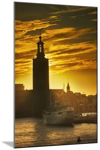 Sunset behind Stadshuset Bell Tower in Stockholm-Jon Hicks-Mounted Photographic Print