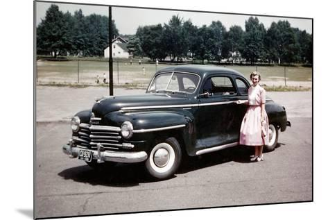 Young Woman Poses with Her Plymouth Automobile, Ca. 1951.-Kirn Vintage Stock-Mounted Photographic Print