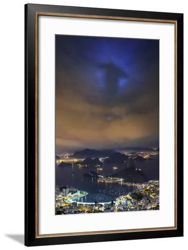 The Shadow of Christ the Redeemer Projected on to Clouds above Rio De Janeiro.-Jon Hicks-Framed Art Print