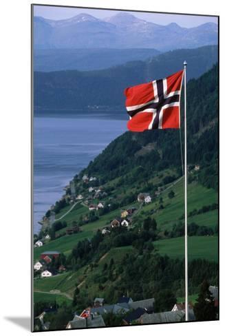 Norwegian Flag Flies above Valley-Paul Souders-Mounted Photographic Print