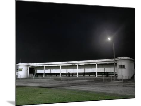 Bus Station at Night-Robert Brook-Mounted Photographic Print