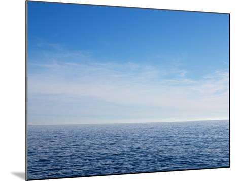 Blue Sky over Calm Sea-Norbert Schaefer-Mounted Photographic Print