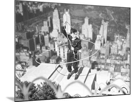 Boy on Ledge Twirling a Lasso--Mounted Photographic Print