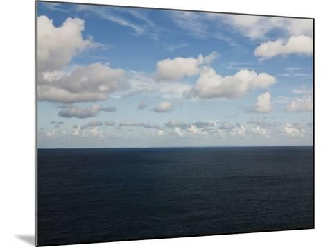 Clouds over Calm Sea-Norbert Schaefer-Mounted Photographic Print