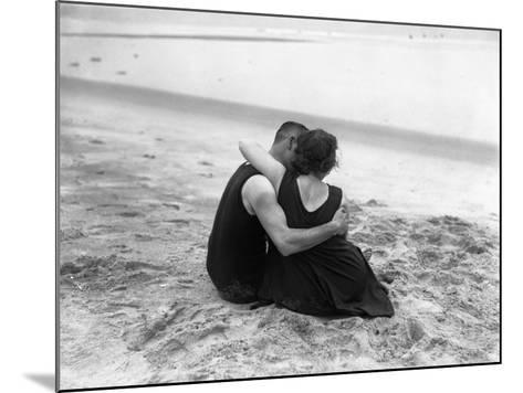 Couple Embracing on Beach--Mounted Photographic Print