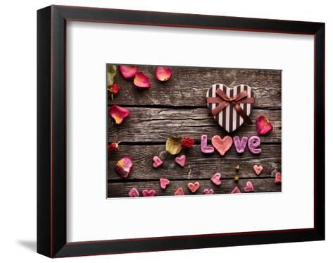 Word Love With Heart Shaped Valentines Day Gift Box On Old Vintage Wooden Plates-ouh_desire-Framed Art Print