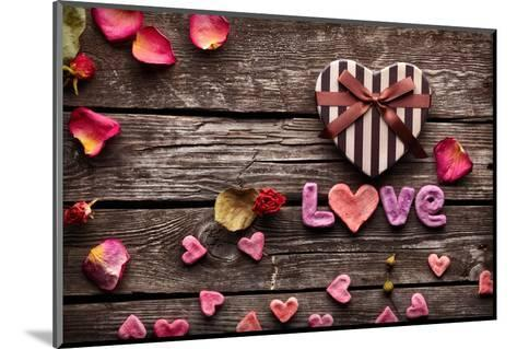 Word Love With Heart Shaped Valentines Day Gift Box On Old Vintage Wooden Plates-ouh_desire-Mounted Photographic Print