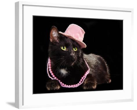 Glamorous Black Cat Wearing Pink Hat And Beads Against Black Background-vitalytitov-Framed Art Print