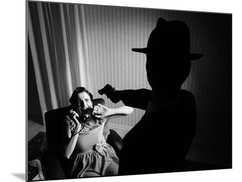 Killer Pointing the Gun at a Terrified Woman-stokkete-Mounted Photographic Print