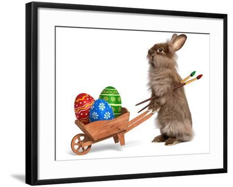 Funny Easter Bunny Rabbit With A Wheelbarrow And Some Easter Eggs-mdorottya-Framed Art Print