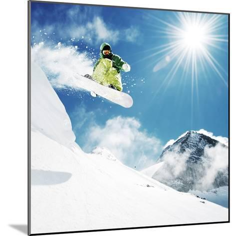 Snowboarder At Jump Inhigh Mountains At Sunny Day-dellm60-Mounted Photographic Print