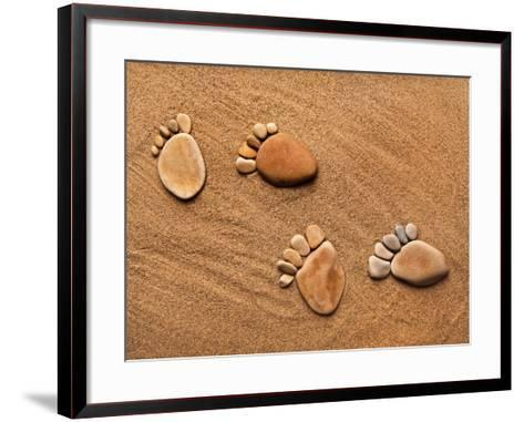 Trace Feet Steps Made Of A Pebble Stone On The Sea Sand Backdrop-Madlen-Framed Art Print