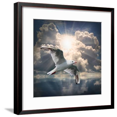 The Seagull Flying Over A Sea Against A Dramatic Sky. Background From Nature-Kletr-Framed Art Print