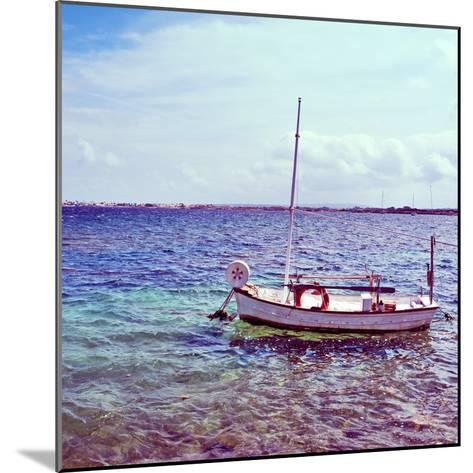 Picture of a Fishing Boat in Estany Des Peix Lagoon, in Formentera, Balearic Islands, Spain-nito-Mounted Photographic Print