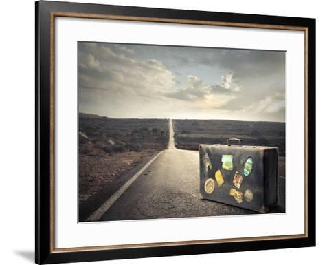 Vintage Suitcase on a Deserted Road-olly2-Framed Art Print