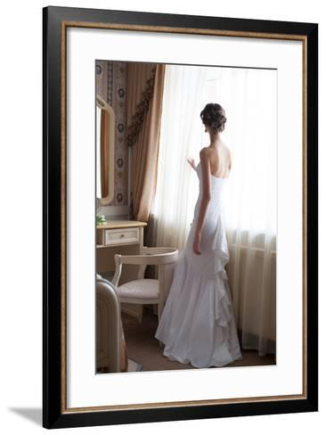 Beautiful Bride in White Wedding Dress Standing in Her Bedroom and Looking in Window- Malyugin-Framed Art Print