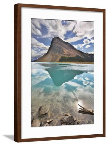 The Huge Rock Of The Triangular Form Is Reflected In Emerald Waters Of Cold Mountain Lake-kavram-Framed Art Print