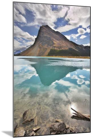 The Huge Rock Of The Triangular Form Is Reflected In Emerald Waters Of Cold Mountain Lake-kavram-Mounted Photographic Print