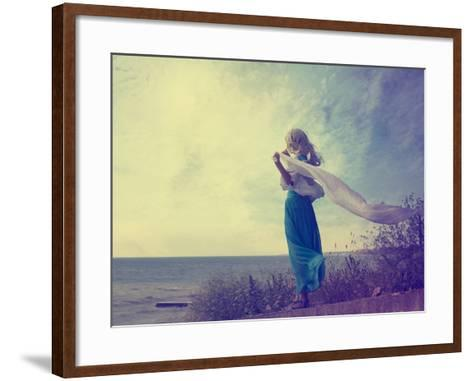 Lonely Woman in Turquoise Dress with Waving Scarf-brickrena-Framed Art Print