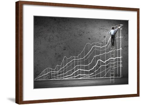 Businessman Drawing Graphics on Wall-Sergey Nivens-Framed Art Print