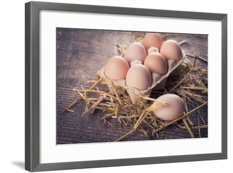 Chicken Eggs on Wooden Background-sobol100-Framed Art Print