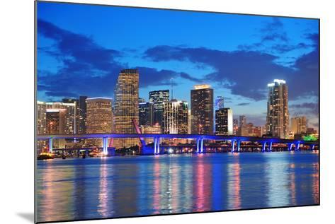 Miami City Skyline Panorama at Dusk with Urban Skyscrapers and Bridge over Sea with Reflection-Songquan Deng-Mounted Photographic Print