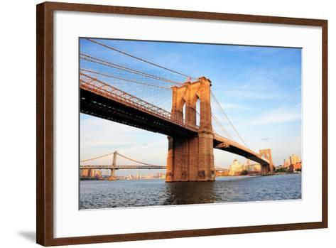 Brooklyn Bridge over East River Viewed from New York City Lower Manhattan Waterfront at Sunset.-Songquan Deng-Framed Art Print