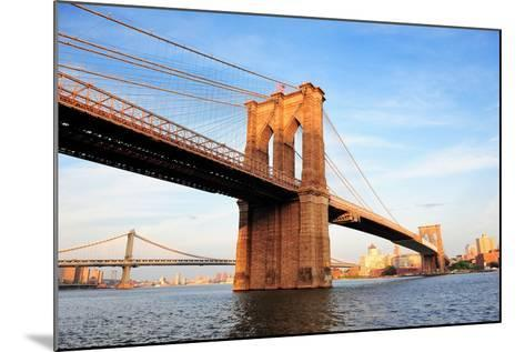 Brooklyn Bridge over East River Viewed from New York City Lower Manhattan Waterfront at Sunset.-Songquan Deng-Mounted Photographic Print