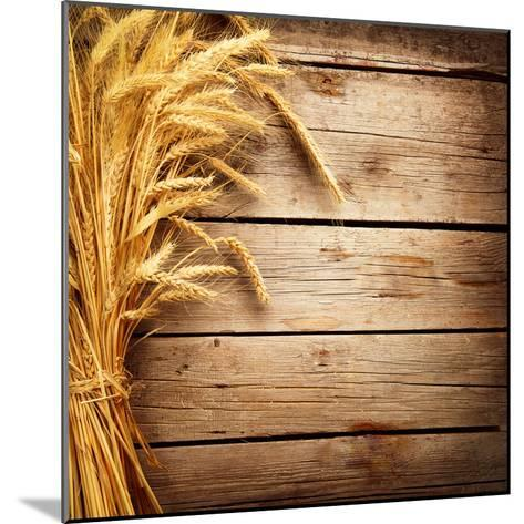 Wheat Ears on the Wooden Table, Sheaf of Wheat over Wood Background-Subbotina Anna-Mounted Photographic Print
