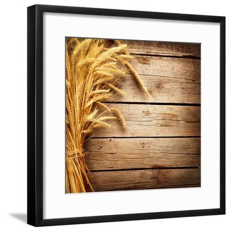 Wheat Ears on the Wooden Table, Sheaf of Wheat over Wood Background-Subbotina Anna-Framed Art Print