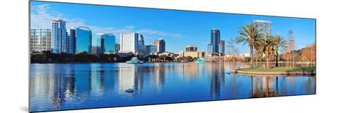 Orlando Lake Eola in the Morning with Urban Skyscrapers and Clear Blue Sky.-Songquan Deng-Mounted Photographic Print