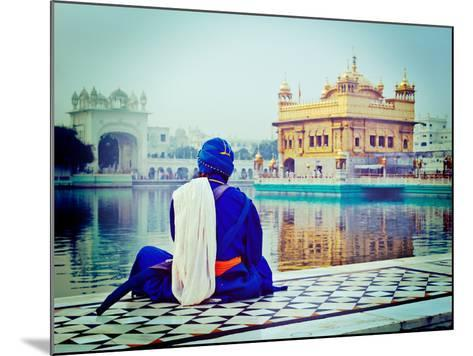 Vintage Retro Hipster Style Travel Image of Unidentifiable Seekh Nihang Warrior Meditating at Sikh-f9photos-Mounted Photographic Print