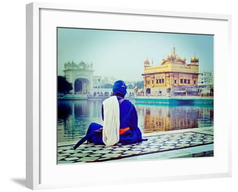 Vintage Retro Hipster Style Travel Image of Unidentifiable Seekh Nihang Warrior Meditating at Sikh-f9photos-Framed Art Print